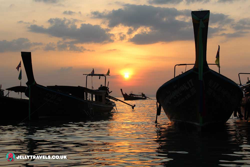 sunset-longtail-boats-railay-beach-krabi